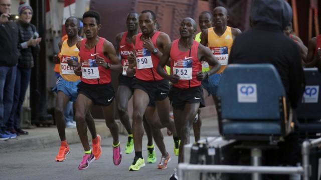 ct-chicago-marathon-drops-rabbits-20150826-001